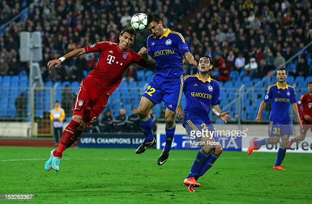 Marko Simic of Borisov and Mario Mandzukic of Muenchen head for the ball the during UEFA Champions League group F match between FC Bayern Muenchen...