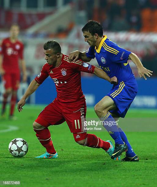 Marko Simic of Borisov and Xherdan Shaqiri of Muenchen battle for the ball during the UEFA Champions League group F match between FC Bayern Muenchen...