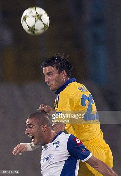 Marko Simic of FC BATE Borisov rises above Shimon Abuhazira of Hapoel Kiryat Shmona FC during the UEFA Champions League PlayOff match between Hapoel...