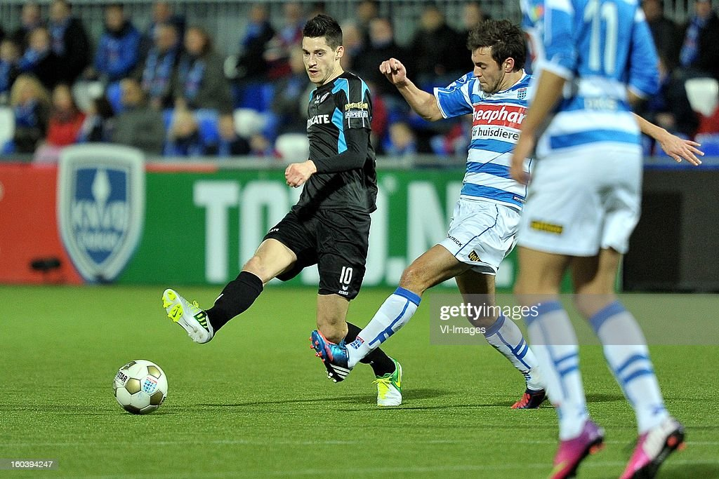 Marko Vejinovic of Heracles Almelo, Bram van Polen of PEC Zwolle during the Dutch Cup match between PEC Zwolle and Heracles Almelo at the IJsseldelta Stadium on january 30, 2013 in Zwolle, The Netherlands