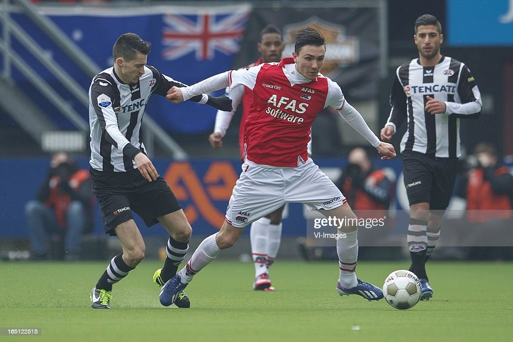 Marko Vejinovic of Heracles Almelo, Steven Berghuis of AZ during the Dutch Eredivisie match between Heracles Almelo and AZ Alkmaar at the Polman Stadium on march 31, 2013 in Almelo, The Netherlands