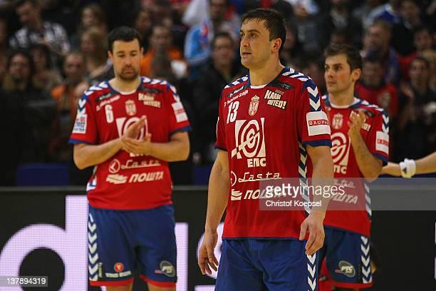 Marko Vujin Momir Ilic and Dalibor Cutura of Serbia look dejected after losing 1921 the Men's European Handball Championship final match between...