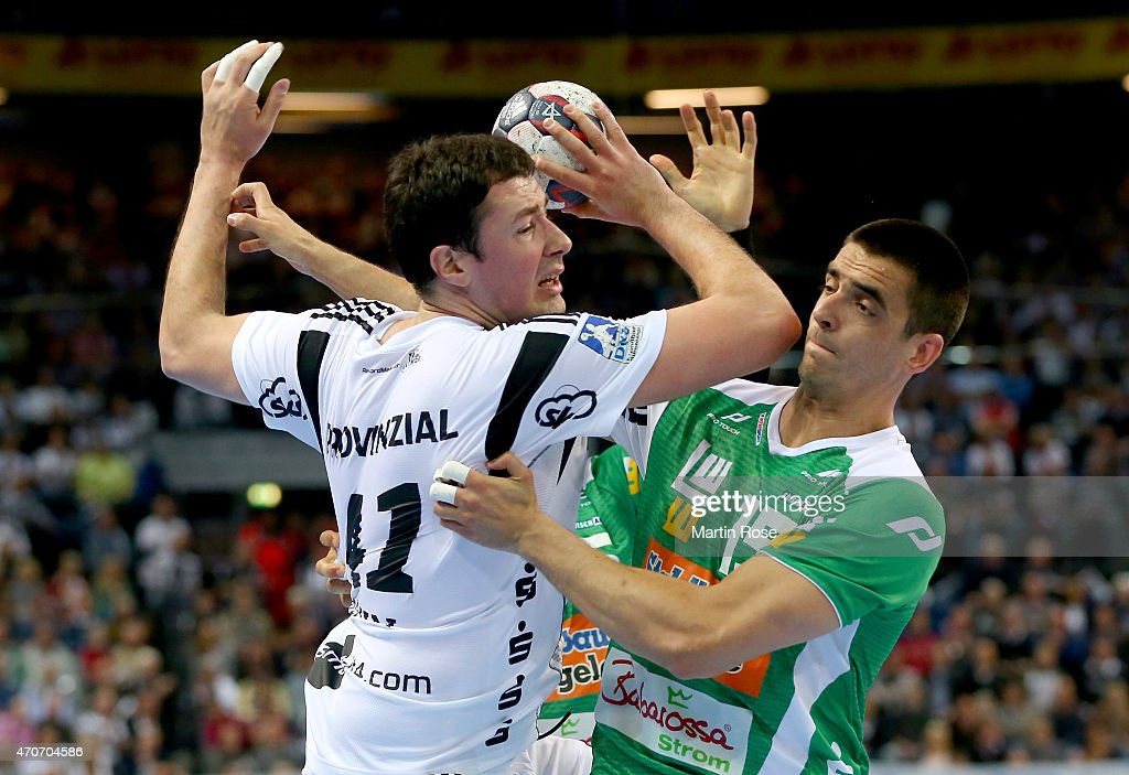 Marko Vujin (L) of Kiel challenges for the ball with <a gi-track='captionPersonalityLinkClicked' href=/galleries/search?phrase=Zarko+Sesum&family=editorial&specificpeople=5668700 ng-click='$event.stopPropagation()'>Zarko Sesum</a> of Goeppingen during the DKB HBL Bundesliga match between THW Kiel and Frisch Auf Goeppingen at Sparkassen Arena on April 22, 2015 in Kiel, Germany.