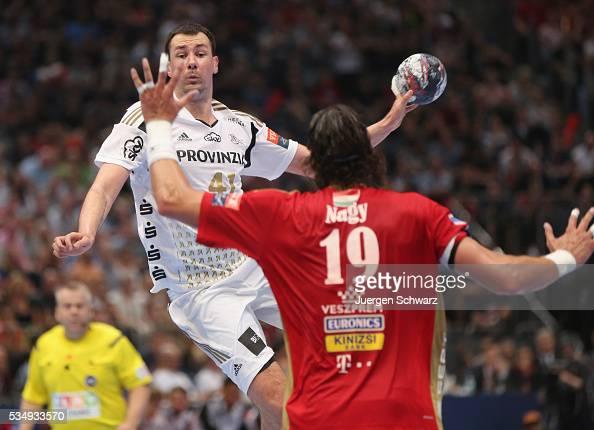 Marko Vujin of Kiel is blocked by Laszlo Nagy of Veszprem during the second semifinal of the EHF Final4 between THW Kiel and MVM Veszprem on May 28...