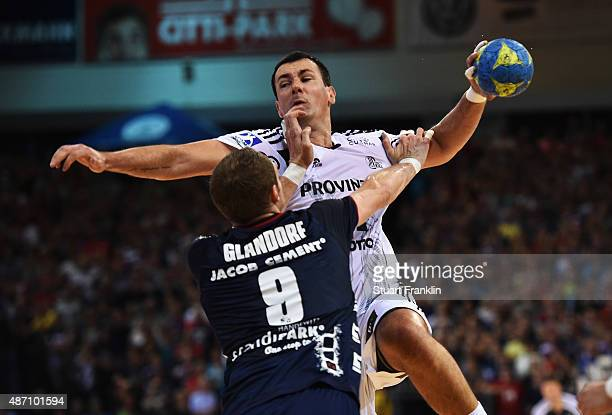 Marko Vujin of Kiel is challenged by Thomas Morgensen of Flensburg during the DKB Handball Bundeslga match between SG FlensburgHandewitt and THW Kiel...