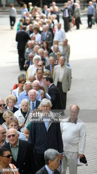 Marks and Spencer shareholders queue to get in to the MS Annual General Meeting at the Royal Festival Hall on the South Bank London