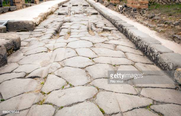 Marks of carts left in Pompeii road.
