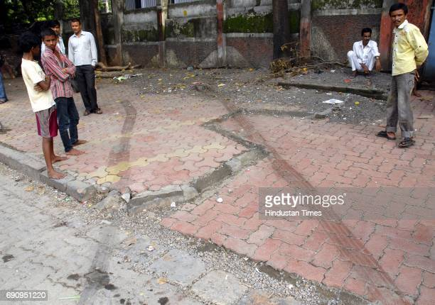 Marks of the tyres at the spot where BEST Van which ran on to two school kids and their mother at the junction of Wadala Bridge and St Josephs High...