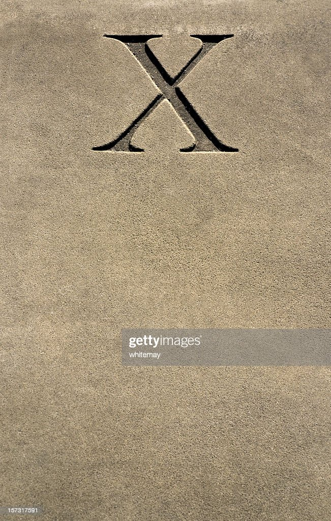 X marks the spot - stone carved numeral or letter