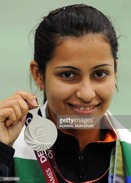 Marksman Heena Sidhu of India poses with her silver medal at the awards ceremony of the women's singles 10m air pistol event of the XIX Commonwealth...