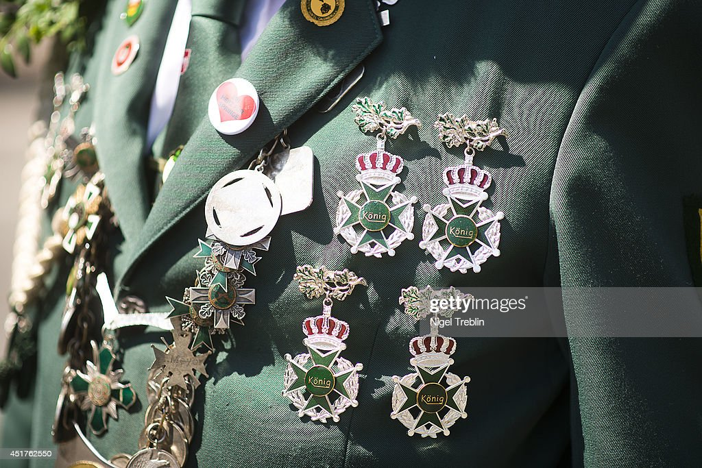 A marksman shows his medals during a parade at the world's largest shooting fair, known as Schutzenfest, on July 6, 2014 in Hanover, Germany. A Schutzenfest, or German 'Marksmen's Festival' is a traditional festival featuring a target shooting competition in the cultures of both Germany and Switzerland. Reports indicate that more than a million visitors are expected to attend the 2014 Marksmen's Festival.
