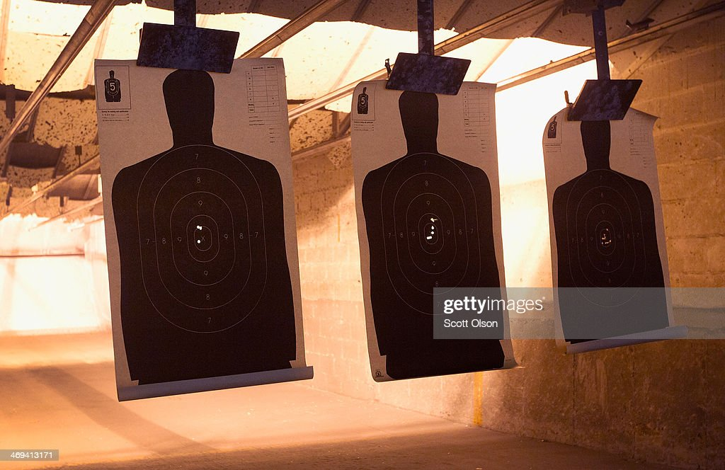 Marksmen shoot at silhouette targets during a class to qualify for an Illinois concealed carry permit on February 14 2014 in Posen Illinois Illinois...