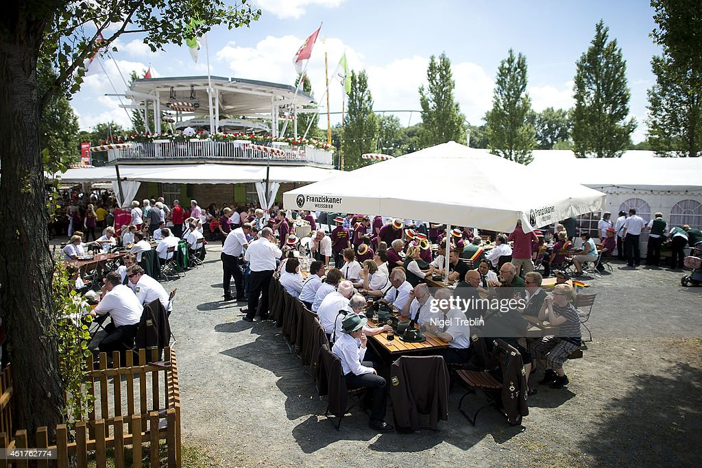 Marksmen sit together drinking beer at the world's largest shooting fair, known as Schutzenfest, on July 6, 2014 in Hanover, Germany. A Schutzenfest, or German 'Marksmen's Festival' is a traditional festival featuring a target shooting competition in the cultures of both Germany and Switzerland. Reports indicate that more than a million visitors are expected to attend the 2014 Marksmen's Festival.