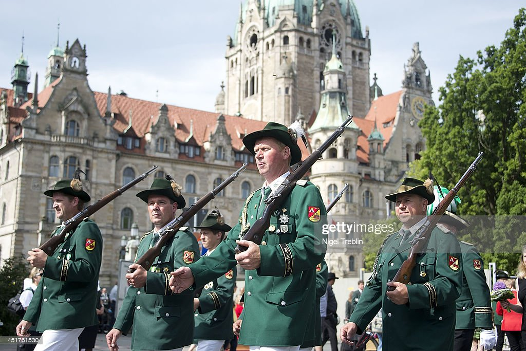 Marksmen take part during a parade at the world's largest shooting fair, known as Schutzenfest, on July 6, 2014 in Hanover, Germany. A Schutzenfest, or German 'Marksmen's Festival' is a traditional festival featuring a target shooting competition in the cultures of both Germany and Switzerland. Reports indicate that more than a million visitors are expected to attend the 2014 Marksmen's Festival.