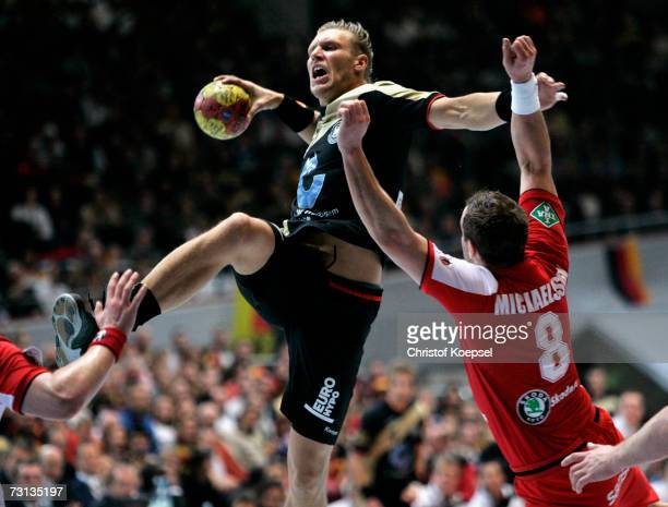 Markus Andreas Jakobsson of Iceland blocks the ball against Lars Kaufmann of Germany during the Men's Handball World Championship Group I game...