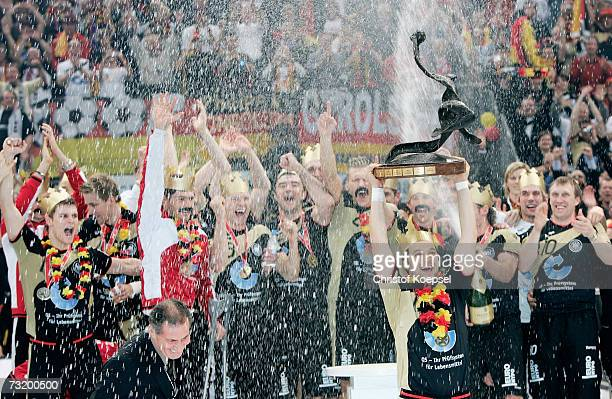 Markus Baur of Germany holds the winning trophee during the ceremony after winning the IHF World Championship final between Germany and Poland at the...