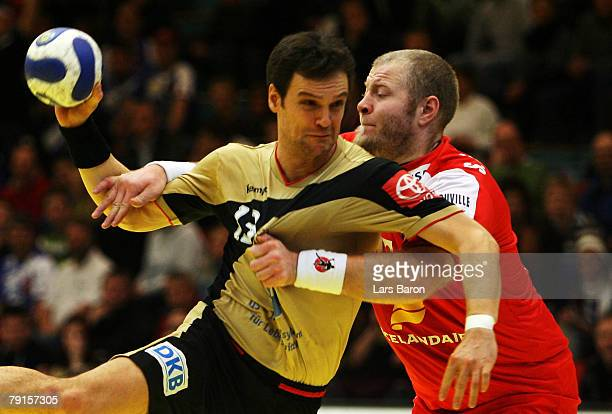 Markus Baur of Germany in action with Sigfus Sigurdsson of Iceland during the Men's Handball European Championship main round Group II match between...
