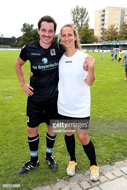 Markus Brandl and his wife Nathalie Schott during the charity football game 'Kick for Kids' to benefit 'Die Seilschaft zusammen sind wir stark eV' at...