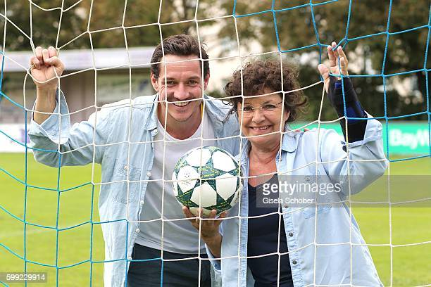 Markus Brandl and Monika Baumgartner standing in the goal during the charity football game 'Kick for Kids' to benefit 'Die Seilschaft zusammen sind...