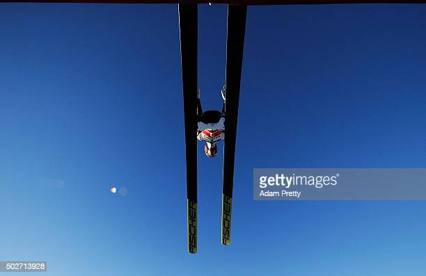 Markus Eisenbichler of Germany launches into the air during his training jump on Day 1 of the 64th Four Hills Tournament ski jumping event on...