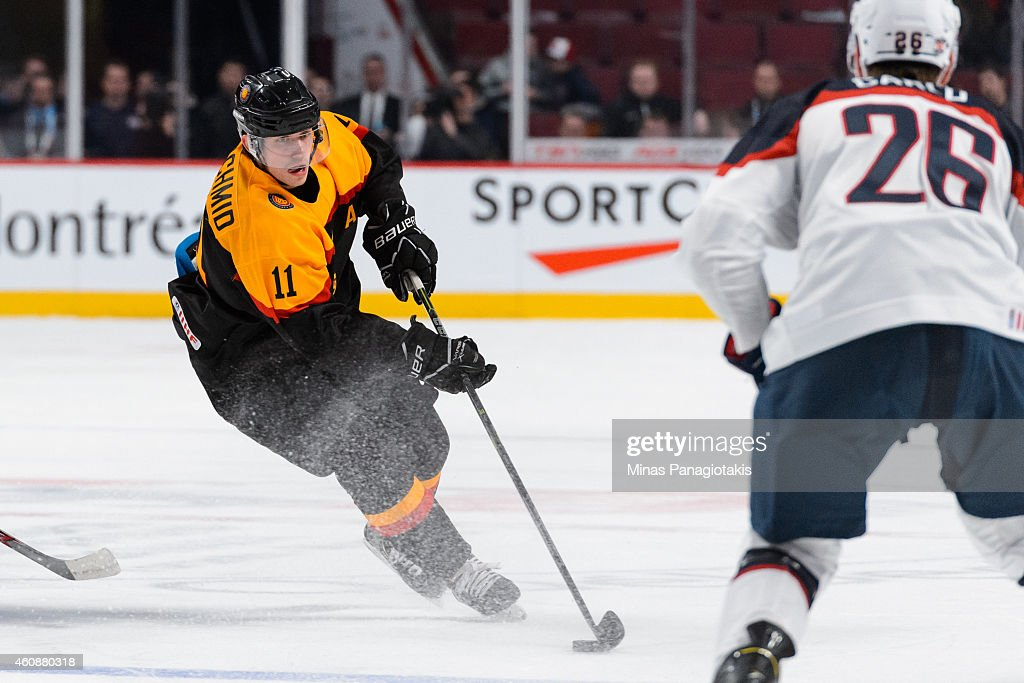 Markus Eisenschmid of Team Germany carries the puck during the 2015 IIHF World Junior Hockey Championship game against Team United States at the Bell...