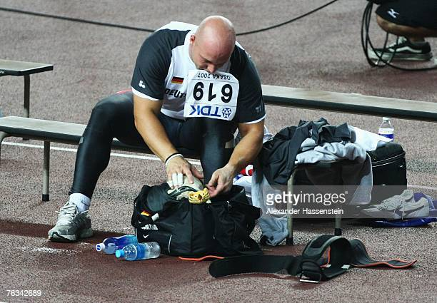 Markus Esser of Germany packs up his bag after competing in the Men's Hammer Throw Final on day three of the 11th IAAF World Athletics Championships...