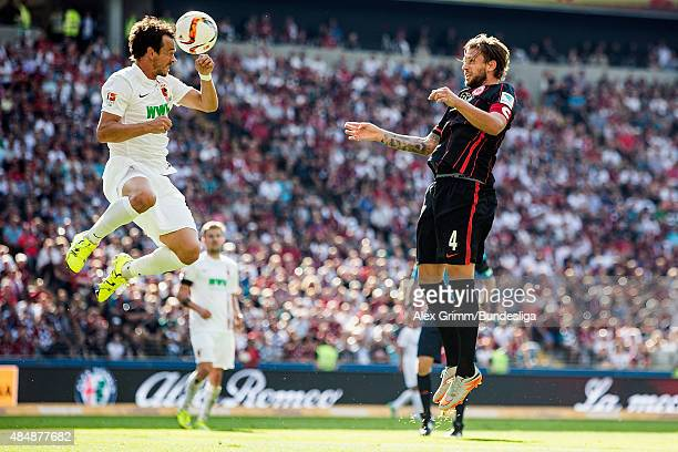 Markus Feulner of Augsburg jumps for a header with Marco Russ of Frankfurt during the Bundesliga match between Eintracht Frankfurt and FC Augsburg at...