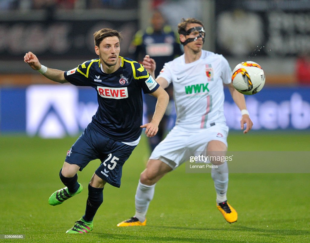 <a gi-track='captionPersonalityLinkClicked' href=/galleries/search?phrase=Markus+Feulner&family=editorial&specificpeople=623655 ng-click='$event.stopPropagation()'>Markus Feulner</a> (R) of FC Augsburg challenges Filip Mladenovic of 1. FC Koeln during the Bundesliga match between FC Augsburg and 1. FC Koeln at WWK Arena on April 29, 2016 in Augsburg, Germany.