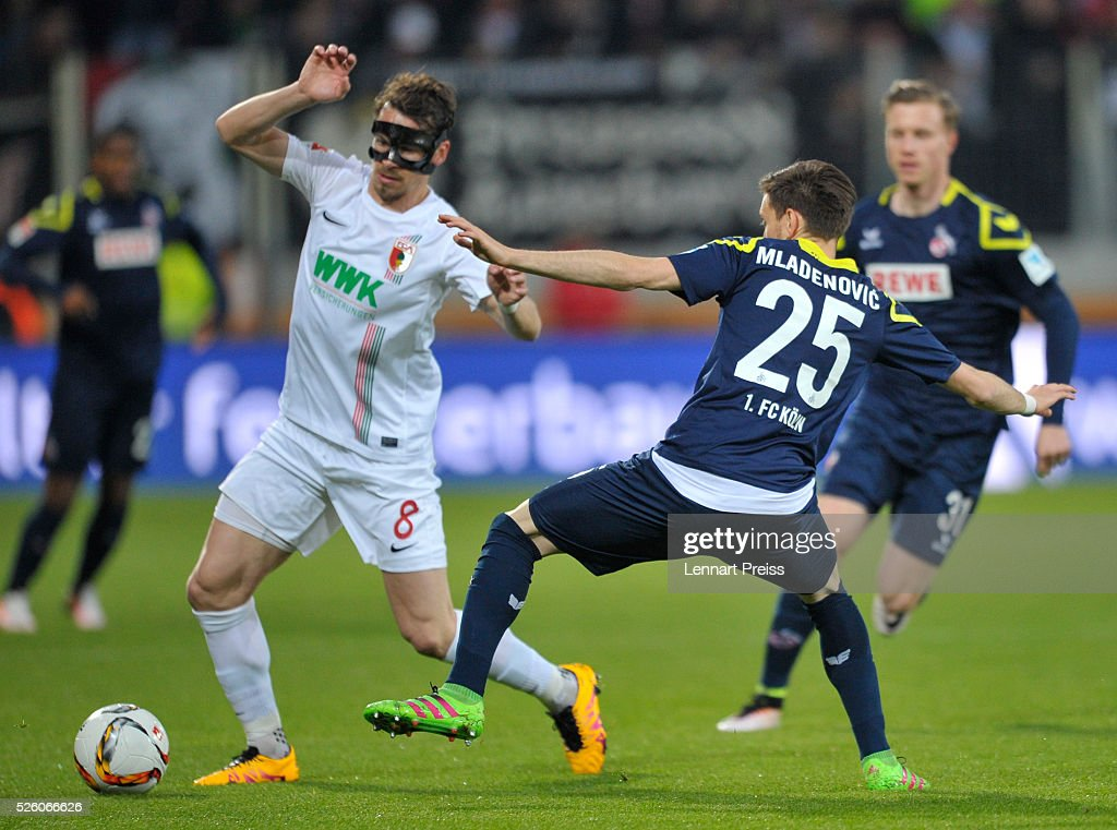 Markus Feulner (L) of FC Augsburg challenges Filip Mladenovic of 1. FC Koeln during the Bundesliga match between FC Augsburg and 1. FC Koeln at WWK Arena on April 29, 2016 in Augsburg, Germany.