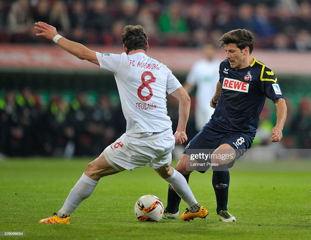 <a gi-track='captionPersonalityLinkClicked' href=/galleries/search?phrase=Markus+Feulner&family=editorial&specificpeople=623655 ng-click='$event.stopPropagation()'>Markus Feulner</a> (L) of FC Augsburg challenges Milos Jojic of 1. FC Koeln during the Bundesliga match between FC Augsburg and 1. FC Koeln at WWK Arena on April 29, 2016 in Augsburg, Germany.