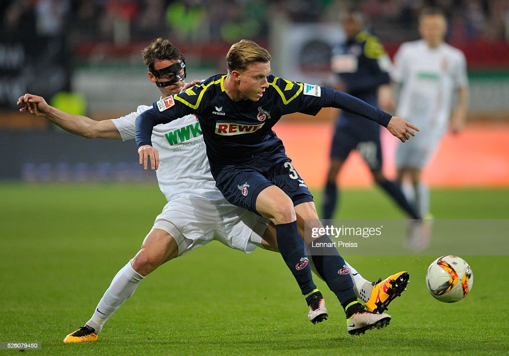 <a gi-track='captionPersonalityLinkClicked' href=/galleries/search?phrase=Markus+Feulner&family=editorial&specificpeople=623655 ng-click='$event.stopPropagation()'>Markus Feulner</a> (L) of FC Augsburg challenges Yannick Gerhardt of 1. FC Koeln during the Bundesliga match between FC Augsburg and 1. FC Koeln at WWK Arena on April 29, 2016 in Augsburg, Germany.
