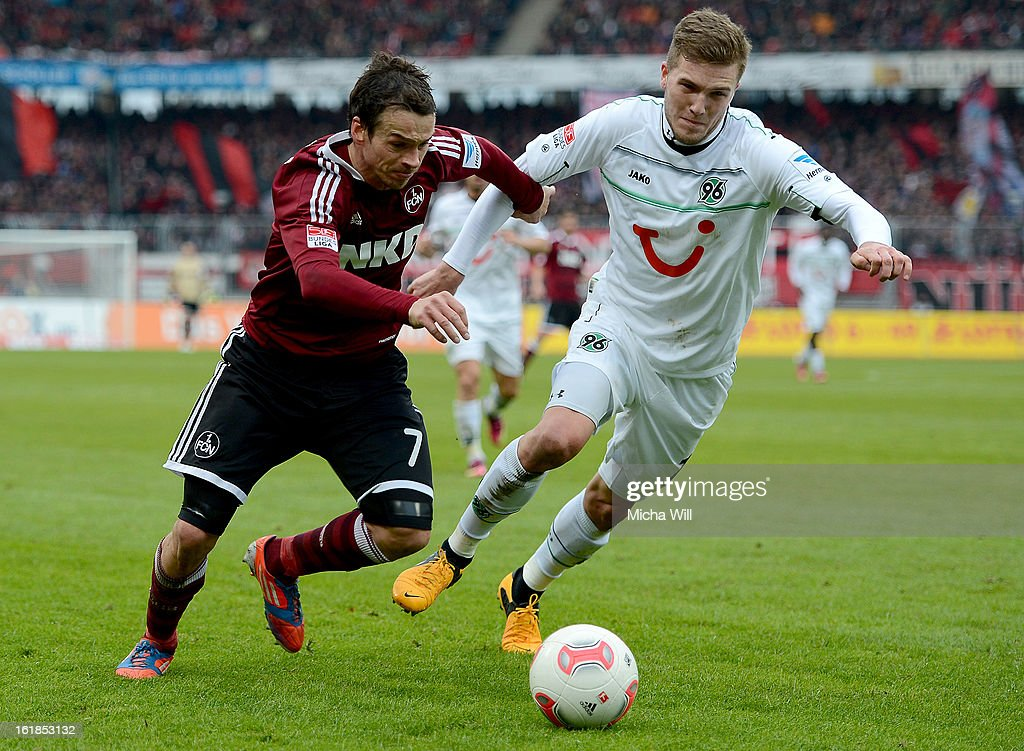 Markus Feulner of Nuernberg (L) and Andre Hoffmann of Hannover compete for the ball during the Bundesliga match between 1. FC Nuernberg and Hannover 96 at Grundig-Stadion on February 17, 2013 in Nuremberg, Germany.