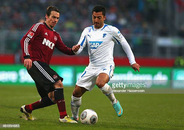Markus Feulner of Nuernberg battles for the ball with Jiloan Hamad of Hoffenheim during the Bundesliga match between 1 FC Nuernberg and TSG 1899...