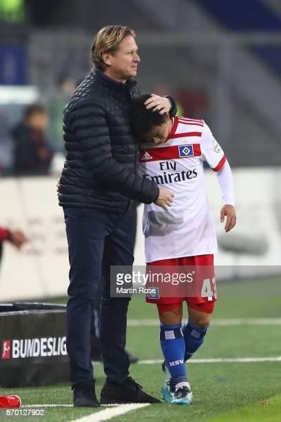 Markus Gisdol coach of Hamburg embraces Tatsuya Ito of Hamburg as he comes off as a substitute during the Bundesliga match between Hamburger SV and...