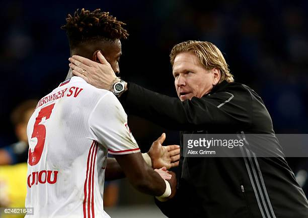Markus Gisdol head coach of Hamburg comforts Johan Djourou after the Bundesliga match between TSG 1899 Hoffenheim and Hamburger SV at Wirsol...