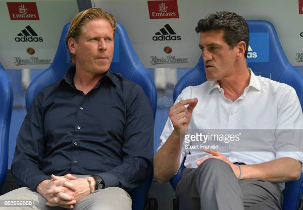 Markus Gisdol head coach of Hamburg discusses with Jens Todt sports director of Hamburger SV during the Bundesliga match between Hamburger SV and 1...