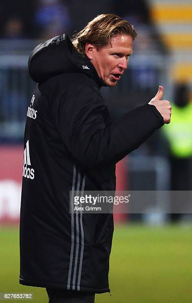 Markus Gisdol head coach of Hamburg gives the thumbs up during the Bundesliga match between SV Darmstadt 98 and Hamburger SV at Stadion am...