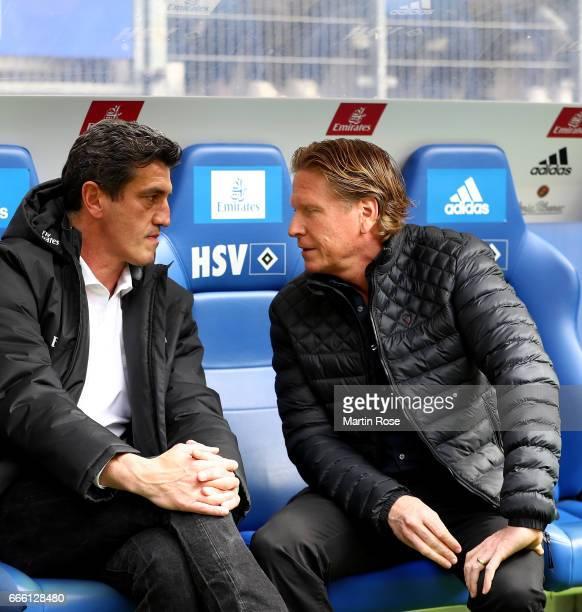 Markus Gisdol head coach of Hamburg talks to sport director Jens Todt before the Bundesliga match between Hamburger SV and TSG 1899 Hoffenheim at...