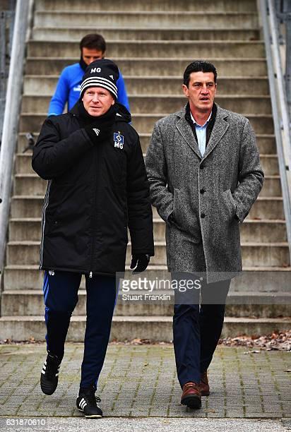 Markus Gisdol head coach of Hamburg walks with Jens Todt sports director of Hamburg during a training session of Hamburger SV on January 17 2017 in...