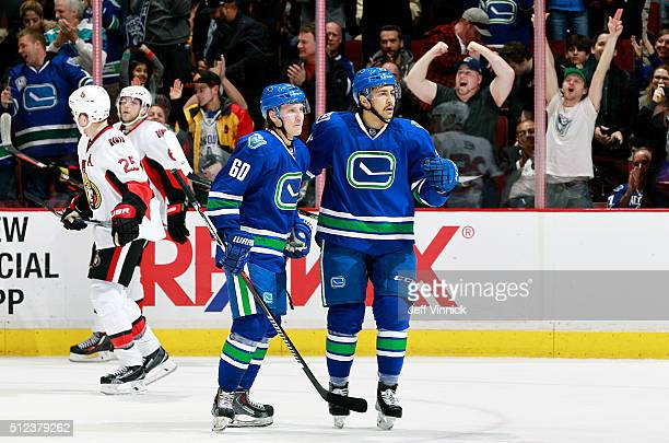 Markus Granlund congratulates Emerson Etem of the Vancouver Canucks who scored against the Ottawa Senators during their NHL game at Rogers Arena...