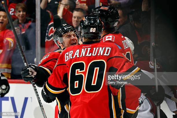 Markus Granlund Lance Bouma and David Jones of the Calgary Flames celebrate a goal against the Colorado Avalanche at Scotiabank Saddledome on March...