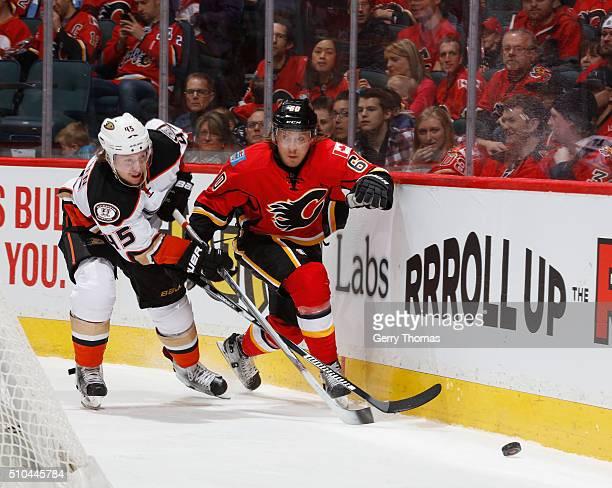Markus Granlund of the Calgary Flames battkes against Sami Vatanen of the Anaheim Ducks at Scotiabank Saddledome on February 15 2016 in Calgary...