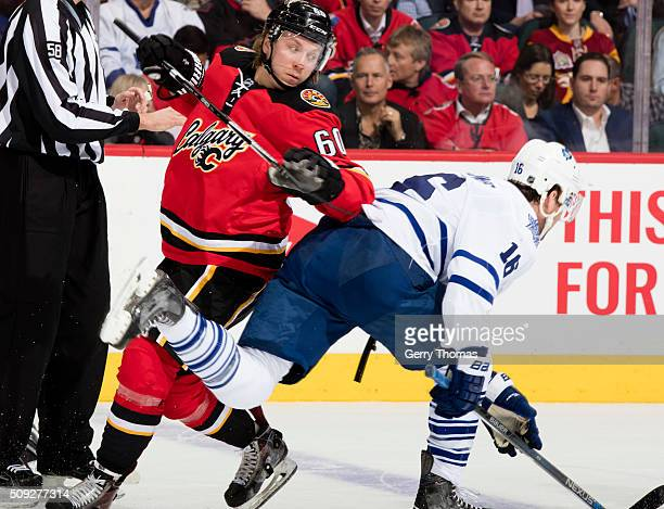 Markus Granlund of the Calgary Flames battles against Nick Spaling of the Toronto Maple Leafs at Scotiabank Saddledome on February 9 2016 in Calgary...