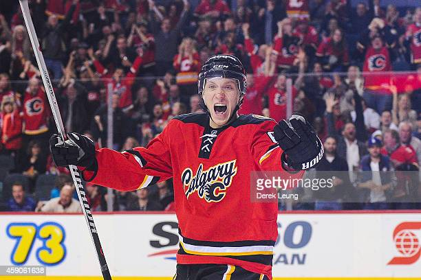 Markus Granlund of the Calgary Flames celebrates a goal by teammate Lance Bouma against the Ottawa Senators during an NHL game at Scotiabank...