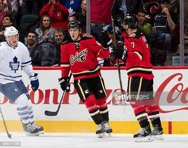 Markus Granlund of the Calgary Flames celebrates with teammate TJ Brodie after a goal against the Toronto Maple Leafs at Scotiabank Saddledome on...