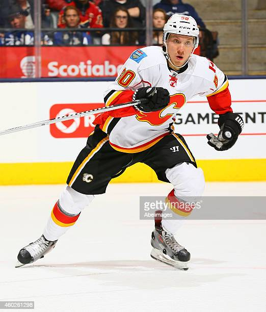 Markus Granlund of the Calgary Flames skates up the ice against the Toronto Maple Leafs during NHL action at the Air Canada Centre December 9 2014 in...