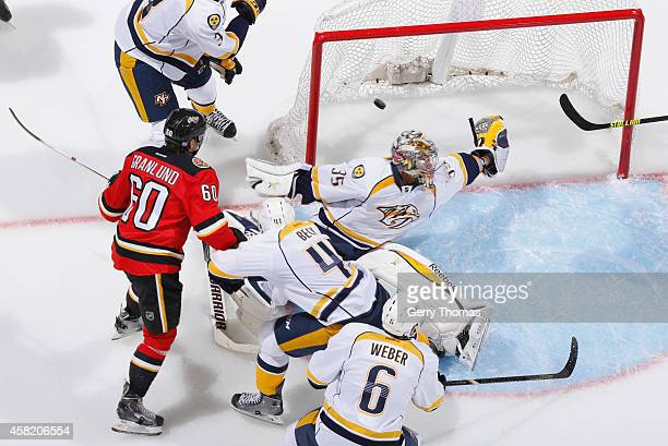 Markus Granlund of the Calgary Flames watches the puck cross the goal line behind a sprawling Pekka Rinne the Nashville Predators at Scotiabank...