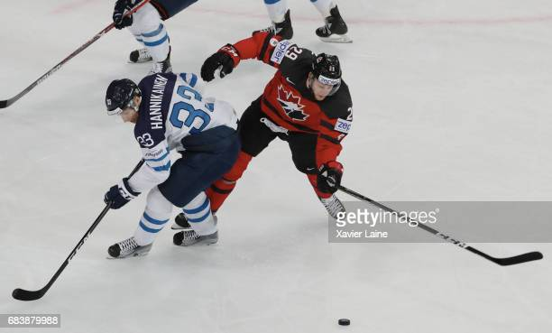 Markus Hannikainen of Finland in action with Nate Mackinnon of Canada during the 2017 IIHF Ice Hockey World Championship game between Canada and...