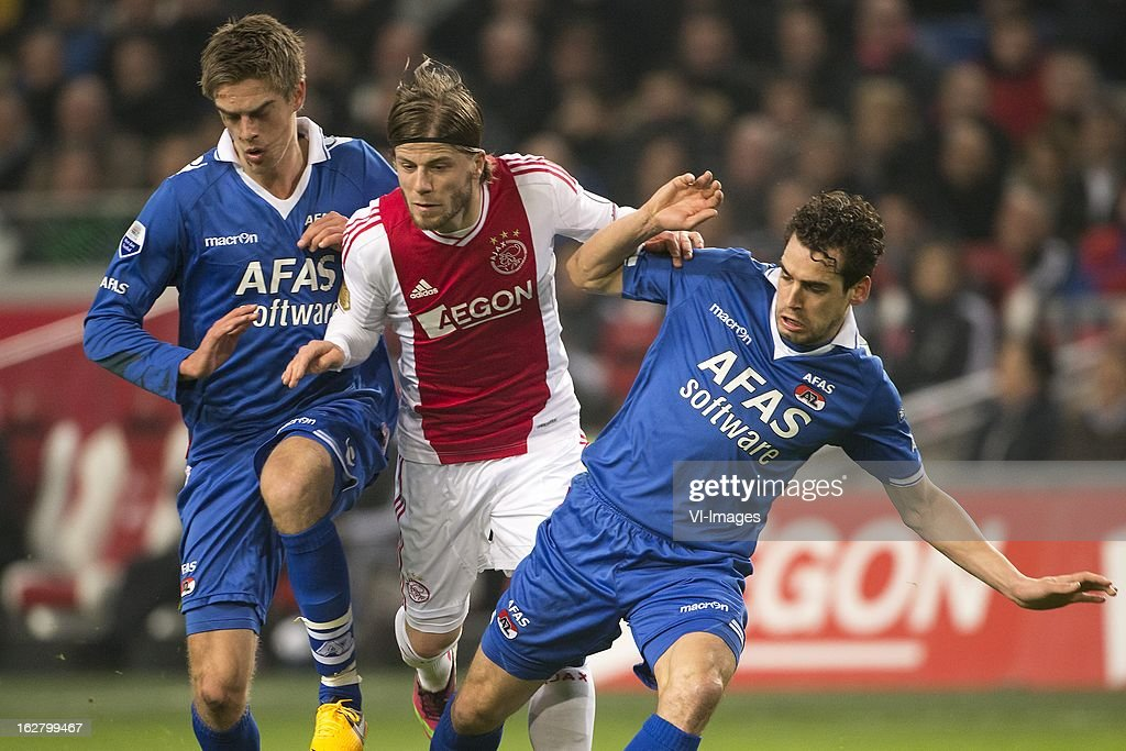 Markus Hendriksen of AZ, Lasse Schone of Ajax, Dirk Marcellis of AZ during the Dutch Cup match between Ajax Amsterdam and AZ Alkmaar at the Amsterdam Arena on february 27, 2013 in Amsterdam, The Netherlands