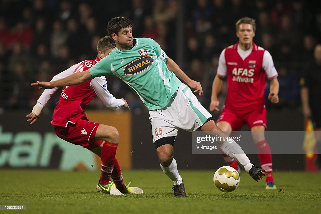 Markus Hendriksen of AZ, Rogier Molhoek of FC Dordrecht during the Dutch Cup match between FC Dordrecht and AZ Alkmaar at the GN Bouw Stadium on December 18, 2012 in Dordrecht, The Netherlands.